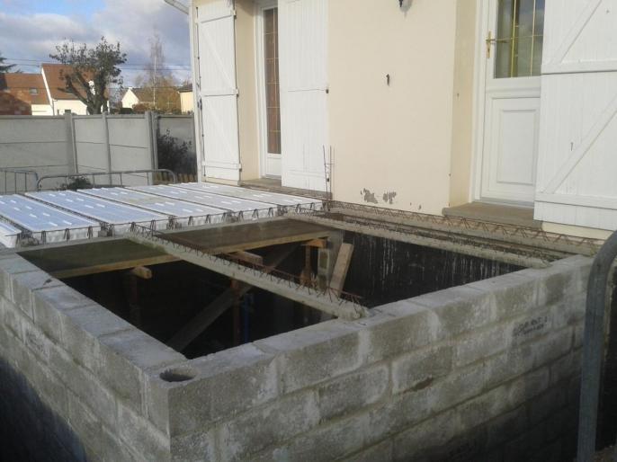 Agrandissement en agglos parpaing avec sous sol for Comment isoler une maison